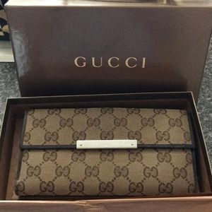 Authentic Gucci Monogrammed Long Wallet.